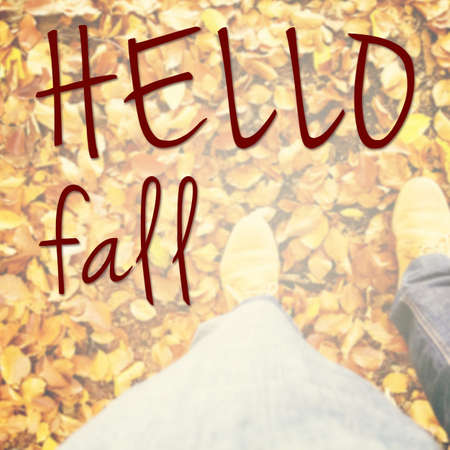 HI: Hello fall inspirational message with person standing in the park on golden foliage