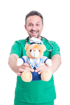 Trustworthy medic or  doctor holding plush bear as pediatric medicine concept isolated on white background