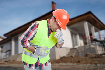 constipation symptom: Sick architect having nausea and abdominal problem while being on construction site