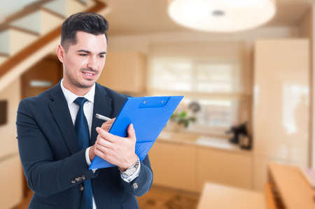 Young realtor writing on clipboard and planning a new investment deal with copy space