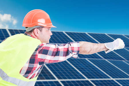 Architect in protection unifrom acting like flying over solar electricity panels Stock Photo