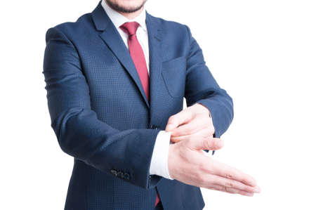 hand cuff: Close-up of business man hand arranging his cuff shirt wearing elegant dark color suit isolated on white background Stock Photo
