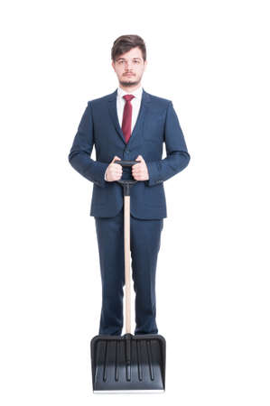 Man wearing suit holding an iron on his jacket isolated on white background Stock Photo