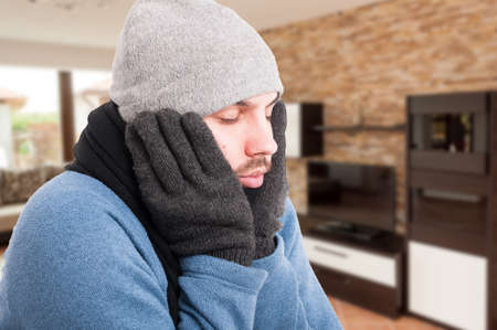 grippe: Close-up of sick man in winter clothes feeling tired as infection or sickness concept