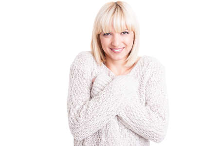 Pretty woman wearing warm sweter standing with arms crossed and smiling isoalated on white background with copy text space