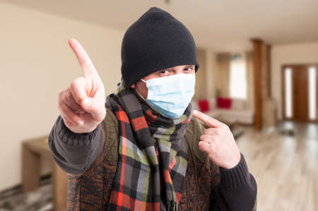 Man wearing medical mask as protection against flu or influenza in winter season