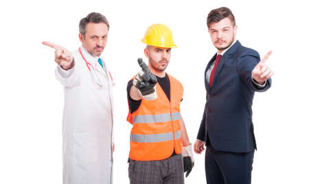Serious men with different jobs showing refusal gesture on white studio background