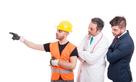 Builder or engineer indicate something to successful doctor and lawyer isolated on white background Stock Photo