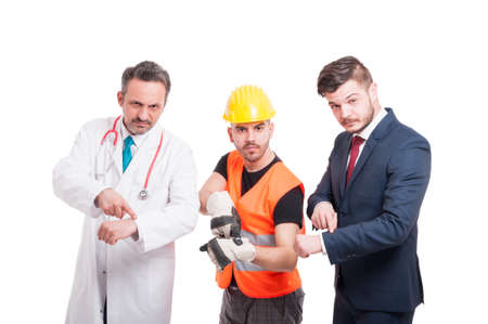punctuality: Doctor or medic, constructor and businessman pointing their wrist as punctuality or appointment concept on white background Stock Photo