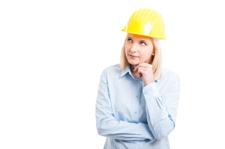 Portrait female engineer making thinking gesture looking up isolated on white background with copy text space