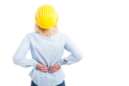 Back view of female engineer holding her back for pain isolated on white background with copy text space