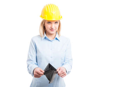 Female engineer wearing helmet showing empty wallet isolated on white background with copy text space