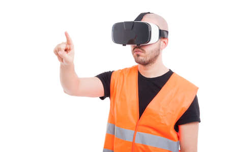 Male engineer pressing on virtual screen while looking thru virtual goggles isolated on white