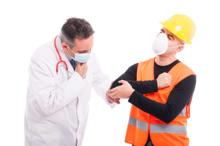 Male doctor checking constructors elbow like consultation concept isolated on white background