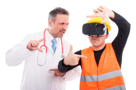 Medic copying constructor trying and gesturing on reality glasses isolated on white background Stock Photo