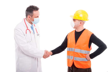 vest in isolated: Doctor and constructor shaking hands like friends or closing a deal isolated on white background