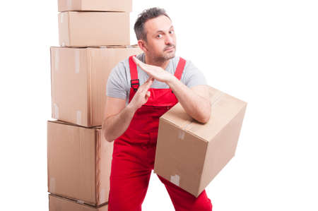 Delivery guy holding box and making time out gesture isolated on white background Stock Photo