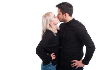 passionately: Loving couple kissing passionately on white studio background with copyspace