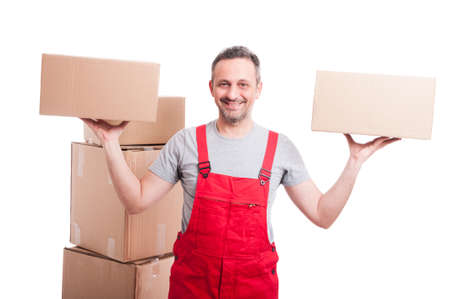 Mover man holding boxes with both hands and smiling isolated on white background