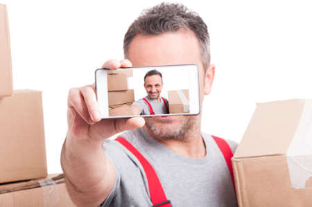 taken: Selective focus of mover guy showing selfie on phone Stock Photo