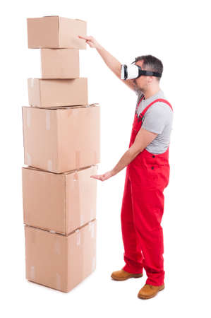 Mover guy wearing virtual reality glasses measuring boxes with hands isolated on white background