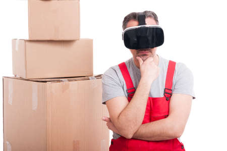 Mover guy wearing virtual reality glasses making thinking gesture isolated on white background Stock Photo