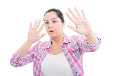 Scared woman raising hands up in defense as danger concept isolated on white