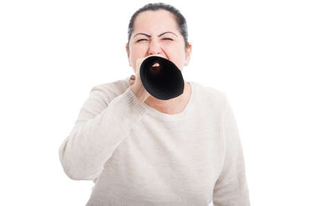 outrage: Young brunette woman talking loud through megaphone made of paper showing authority on white background Stock Photo