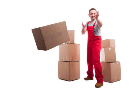 Full body mover guy throwing a cardboard box like working isolated on white background