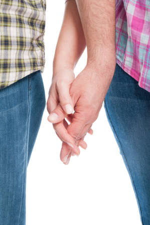 Close-up of lovers holding hands together as attachement concept on white background