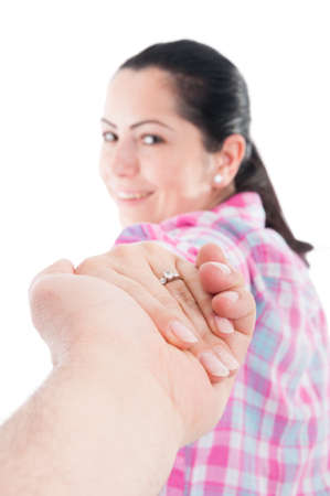 Man holding female hand with engagement ring as wedding concept isolated on white Stock Photo