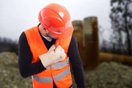 Young construction worker having chest pain or palpitation at working place