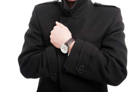 Close-up of  elegant man posing wearing overcoat and watch isolated on white background Stock Photo