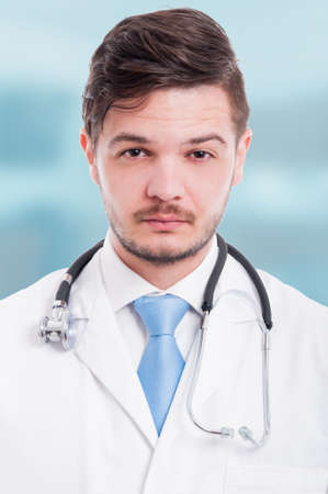 Portrait of a confident and serious male doctor with stethoscope and white coat Stock Photo