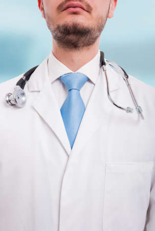 Portrait of unknown male doctor in medical uniform with stethoscope in close-up view Stock Photo