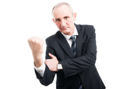 obscene: Middle aged elegant man showing obscene gesture wearing suit and tie isolated on white background with copy text space