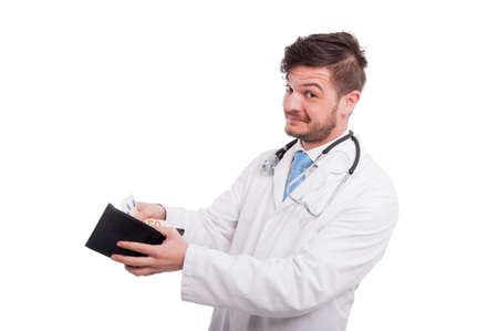 doctor putting money: Joyful medical doctor putting money in wallet and smiling on white studio background Stock Photo