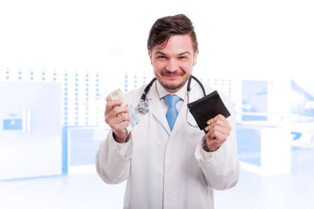 doctor money: Male cardiologist in medical uniform enjoying his succes and money gain Stock Photo