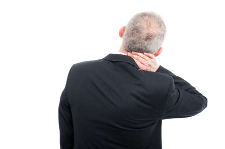Back view of senior holding his back neck like hurting wearing suit and tie isolated on white background with copy text space