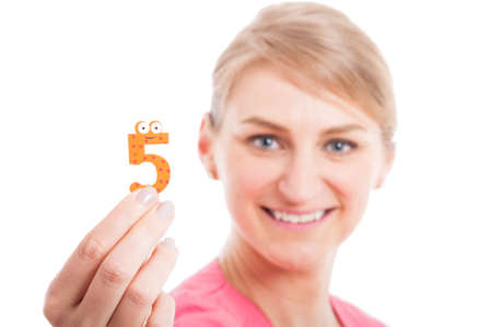 counting five: Selective focus close-up of smiling pediatrician lady showing number five isolated on white background with copy text space