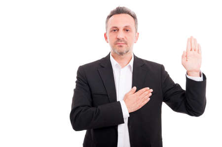 Businessman taking oath or making a promise as sign of loyalty on white background Фото со стока