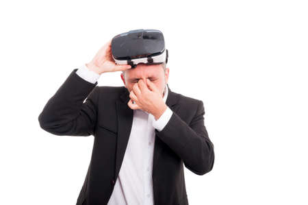 thru: Young male looking exhausted after 3d experience thru virtual reality headset isolated on white background Stock Photo