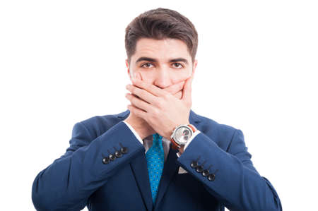 Portrait of young lawyer holding hands on mouth. Speak no evil concept on white background