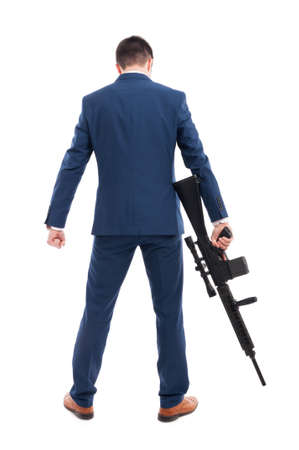 Back view of accountant armed with a rifle acting like a hitman on white background Stock Photo
