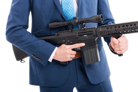 Hitman hands holding military weapon in close up being ready to take a shoot Stock Photo