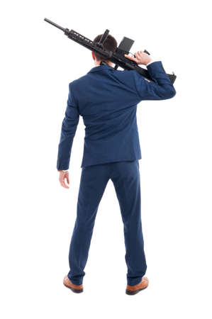 Businessman or shooter holding a machine gun in rear view isolated on white background