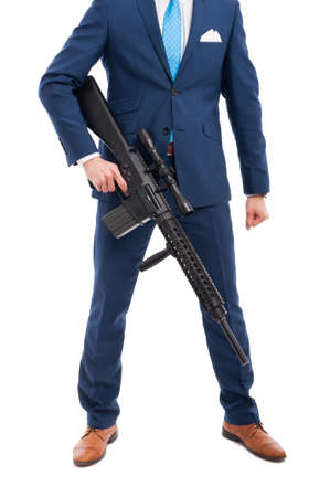Unknown salesman or secret killer with big weapon isolated on white background