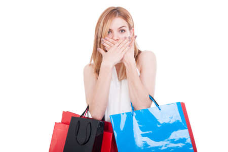 Shopping woman doing speak no evil gesture on white studio background Stock Photo