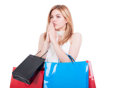 Female shopper with paper bags holding hands clasped and hoping for great sales at the mall isolated on white background