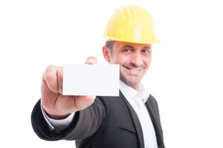 trustworthy: Selective focus of architect showing blank business card and smiling isolated on white background with copy text space
